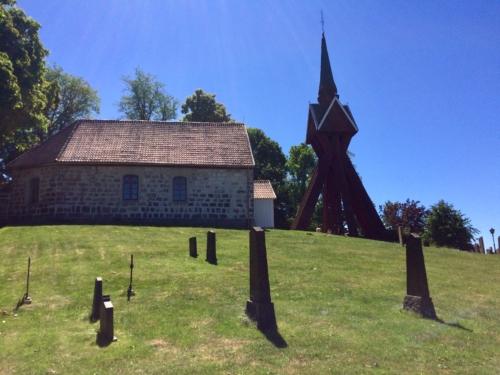 Velinga Kyrka and bell tower.